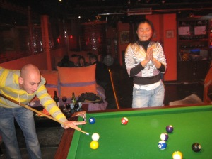 My friend playing pool with one of our new 'friends'